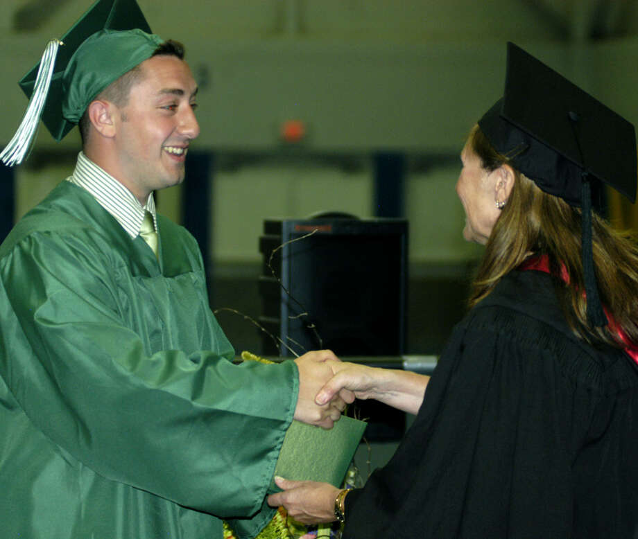 Nicholas Groccia receives his diploma from Board of Education chairwoman Wendy Faulenbach during New Milford High School's commencement exercises at the O'Neill Center on the campus of Western Connecticut State University in Danbury. June 22, 2013 Photo: Norm Cummings