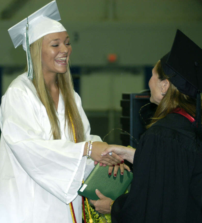 Valerie Henonen receives her diploma from Board of Education chairwoman Wendy Faulenbach during New Milford High School's commencement exercises at the O'Neill Center on the campus of Western Connecticut State University in Danbury. June 22, 2013 Photo: Norm Cummings