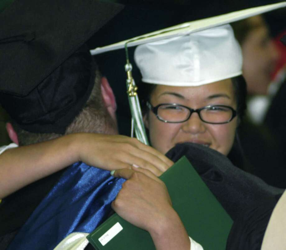Li Ting Lin gives NMHS math teacher Ryan Fitzsimmons a heartfelt hug during New Milford High School's commencement exercises at the O'Neill Center on the campus of Western Connecticut State University in Danbury. June 22, 2013 Photo: Norm Cummings