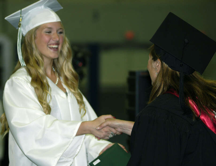 Cailin McLaughlin receives her diploma from Board of Education chairwoman Wendy Faulenbach during New Milford High School's commencement exercises at the O'Neill Center on the campus of Western Connecticut State University in Danbury. June 22, 2013 Photo: Norm Cummings