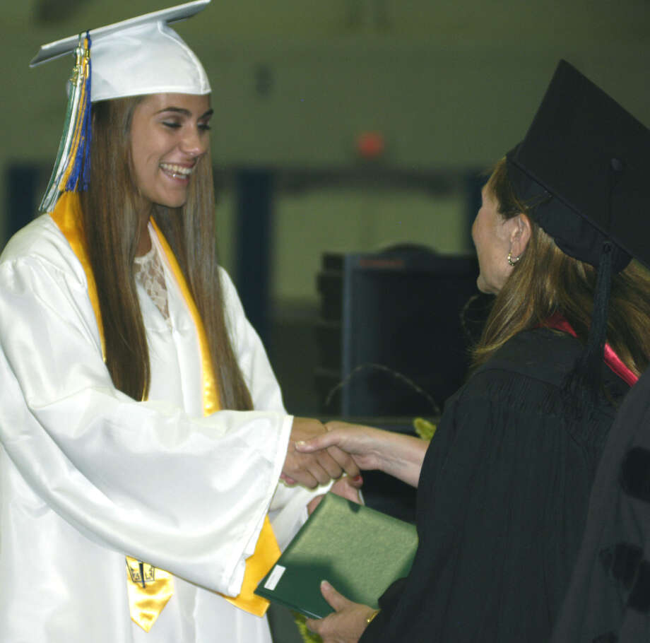 Cristina Munoz receives her diploma from Board of Education chairwoman Wendy Faulenbach during New Milford High School's commencement exercises at the O'Neill Center on the campus of Western Connecticut State University in Danbury. June 22, 2013 Photo: Norm Cummings