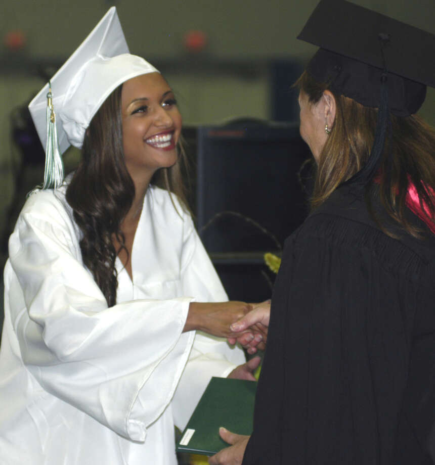 Roxanne Nagarwalla receives her diploma from Board of Education chairwoman Wendy Faulenbach during New Milford High School's commencement exercises at the O'Neill Center on the campus of Western Connecticut State University in Danbury. June 22, 2013 Photo: Norm Cummings