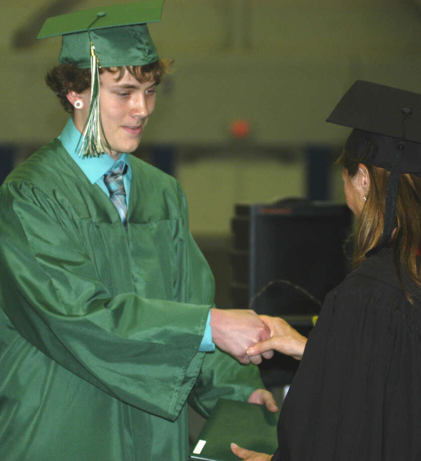 Colby Nelson receives his diploma from Board of Education chairwoman Wendy Faulenbach during New Milford High School's commencement exercises at the O'Neill Center on the campus of Western Connecticut State University in Danbury. June 22, 2013 Photo: Norm Cummings