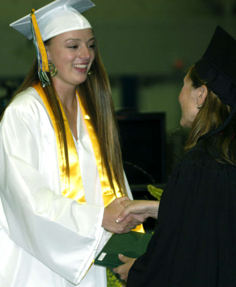 Jessica Noteware receives her diploma from Board of Education chairwoman Wendy Faulenbach during New Milford High School's commencement exercises at the O'Neill Center on the campus of Western Connecticut State University in Danbury. June 22, 2013 Photo: Norm Cummings