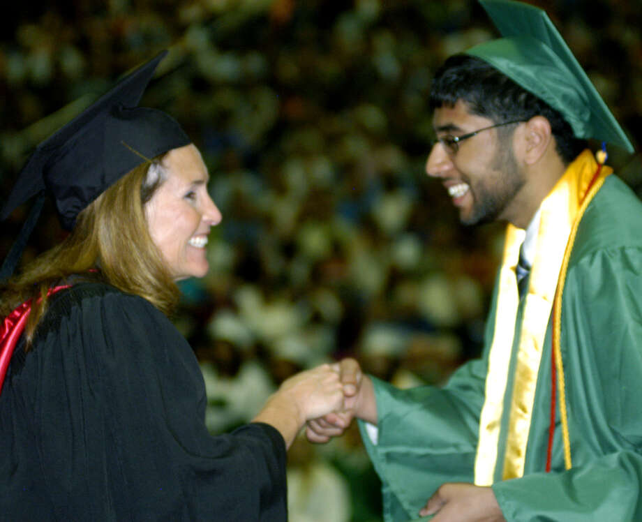 Dalit Sharma receives his diploma from Board of Education chairwoman Wendy Faulenbach during New Milford High School's commencement exercises at the O'Neill Center on the campus of Western Connecticut State University in Danbury. June 22, 2013 Photo: Norm Cummings