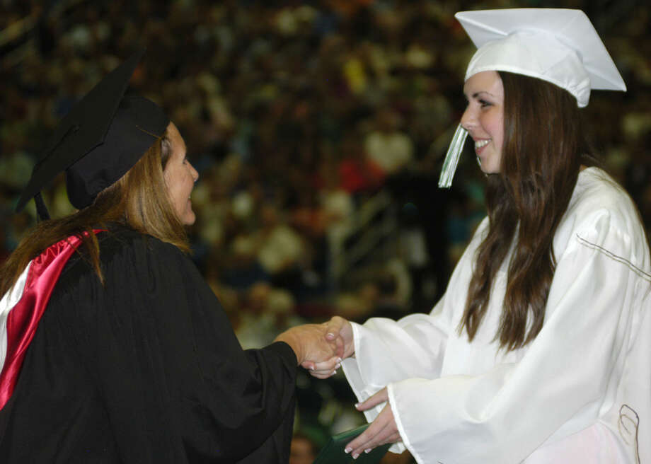 Michelle Strand receives her diploma from Board of Education chairwoman Wendy Faulenbach during New Milford High School's commencement exercises at the O'Neill Center on the campus of Western Connecticut State University in Danbury. June 22, 2013 Photo: Norm Cummings
