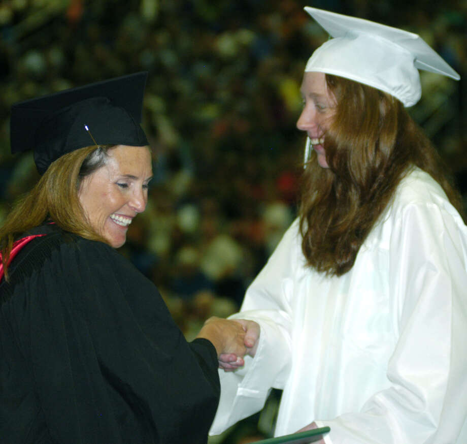 Kasey Strobino receives her diploma from Board of Education chairwoman Wendy Faulenbach during New Milford High School's commencement exercises at the O'Neill Center on the campus of Western Connecticut State University in Danbury. June 22, 2013 Photo: Norm Cummings