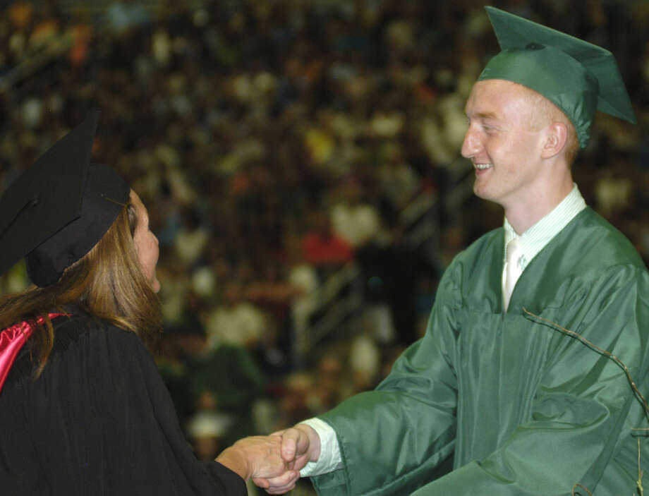 Mirza Tahironic receives his diploma from Board of Education chairwoman Wendy Faulenbach during New Milford High School's commencement exercises at the O'Neill Center on the campus of Western Connecticut State University in Danbury. June 22, 2013 Photo: Norm Cummings