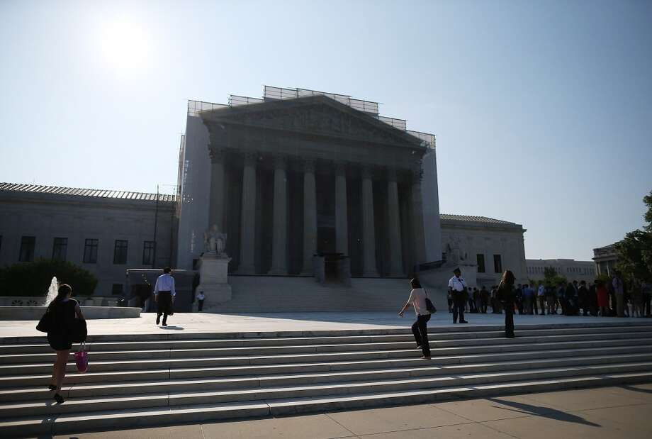 WASHINGTON, DC - JUNE 24:  People wait to enter the U.S. Supreme Court building June 24, 2013 in Washington DC. The high court may rule on several cases including Hollingsworth v. Perry which challenges California's Proposition 8, a ban on same sex marriage.