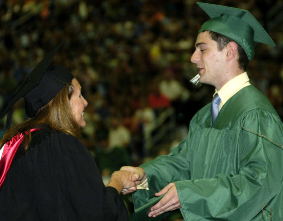 Nickolas Teixeira receives his diploma from Board of Education chairwoman Wendy Faulenbach during New Milford High School's commencement exercises at the O'Neill Center on the campus of Western Connecticut State University in Danbury. June 22, 2013 Photo: Norm Cummings