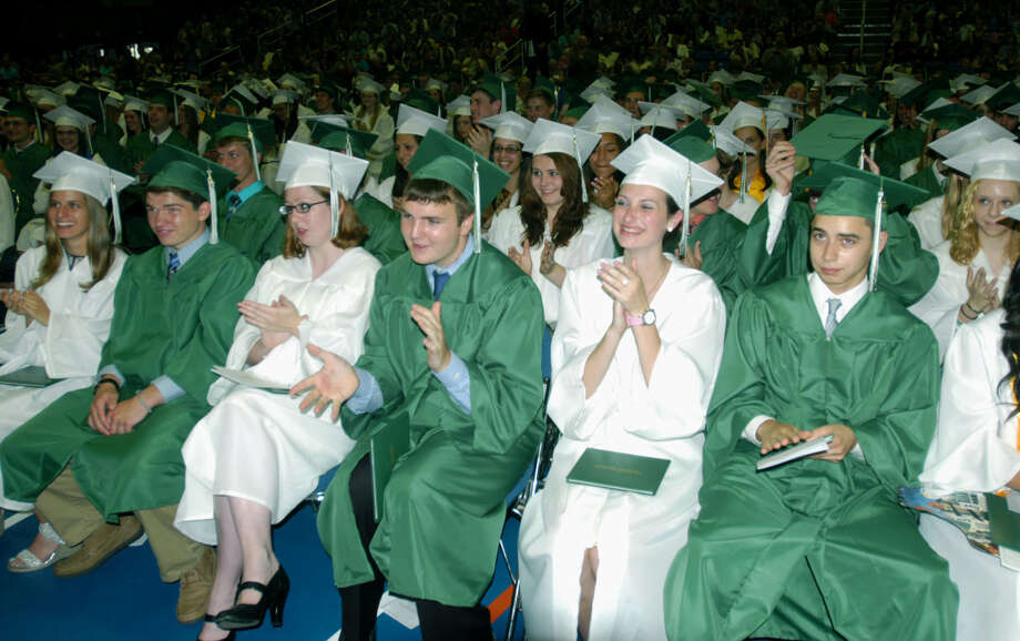 Their tassels turned, the graduates acknowledge Class of 2013 president Ben Lawson during New Milford High School's commencement exercises at the O'Neill Center on the campus of Western Connecticut State University in Danbury. June 22, 2013 Photo: Norm Cummings