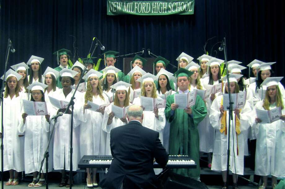 Graduating singers from the NMHS chorus perform with keyboard accompaniment from director Bob Keck during New Milford High School's commencement exercises at the O'Neill Center on the campus of Western Connecticut State University in Danbury. June 22, 2013 Photo: Norm Cummings