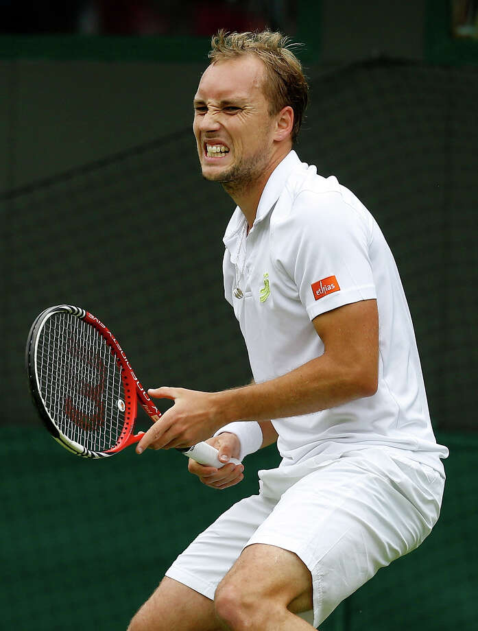 Steve Darcis of Belgium grimaces during his Men's first round singles match against Rafael Nadal of Spain at the All England Lawn Tennis Championships in Wimbledon, London, Monday, June 24, 2013. Photo: Kirsty Wigglesworth, AP / AP
