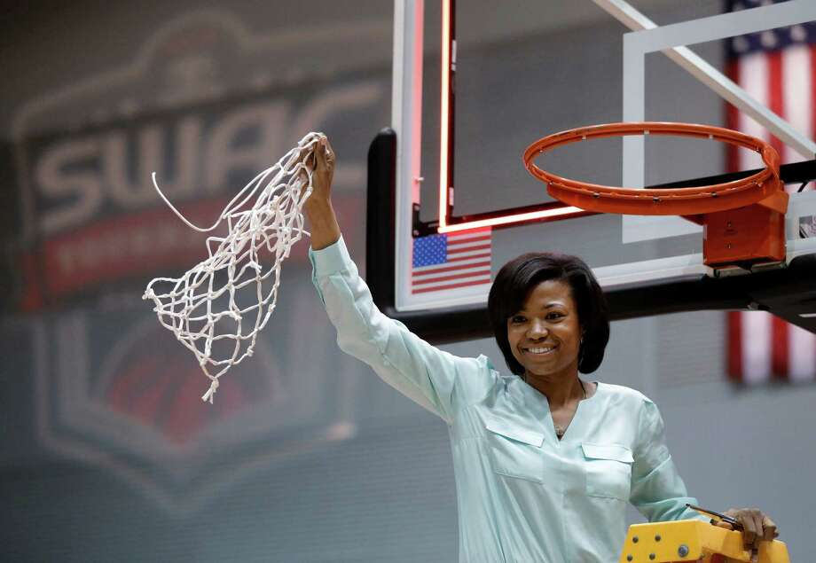 Prairie View A&M coach Toyelle Wilson holds up the net following an NCAA college basketball game against Mississippi Valley State for the championship of Southwestern Athletic Conference women's tournament Saturday, March 16, 2013, in Garland, Texas. Prairie View won in quadruple overtime, 100-87. (AP Photo/Tony Gutierrez) Photo: Tony Gutierrez, Associated Press / AP