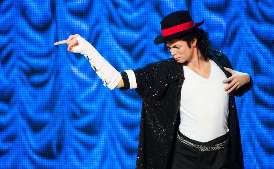 A waxwork figure of Michael Jackson stands on stage as Madame Tussauds unveil 3 new Michael Jackson waxworks/