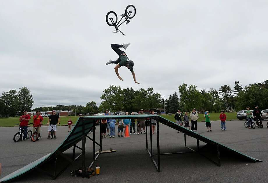 Back to the drawing board: Lucas Hastay's back flip doesn't go as planned at the Outcast BMX team demonstration in Weston, Wis. He was not hurt. Photo: Dan Young, Associated Press