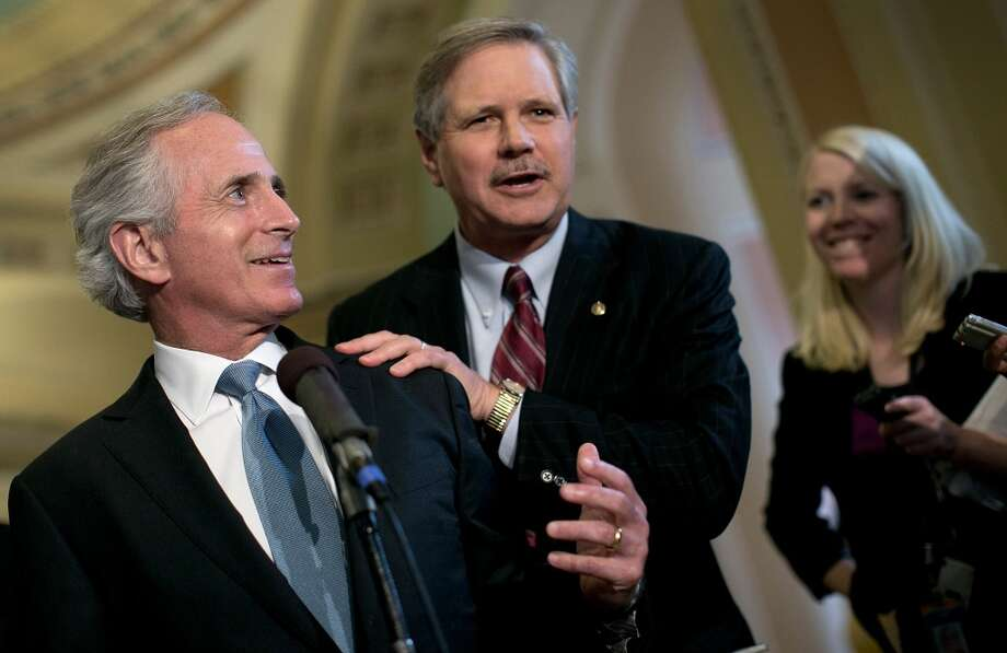 "WASHINGTON, DC - JUNE 20:  Sen. Bob Corker (L) (R-TN) and Sen. John Hoeven (R) (ND) discuss their immigration agreement outside the Senate chamber June 20, 2013 in Washington, DC. Corker and Hoeven carved out an agreement designed to fortify border security with the ""Group of Eight"", a bipartisan group of Senators, that drafted an overhaul of U.S. immigration laws."