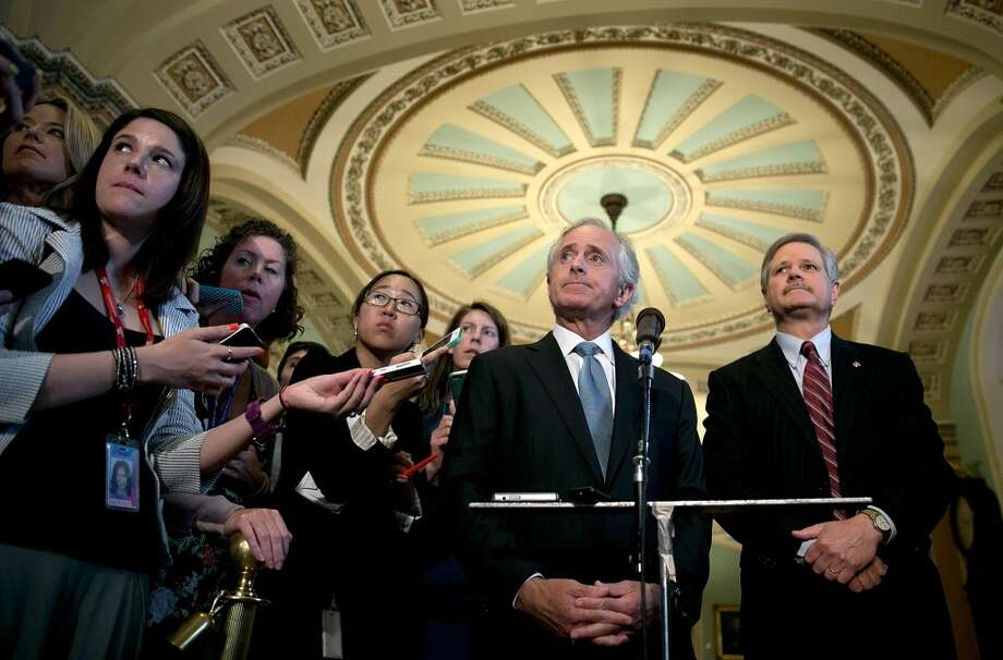 "Sen. Bob Corker (L) (R-TN) and Sen. John Hoeven (R) (ND) discuss their immigration agreement outside the Senate chamber June 20, 2013 in Washington, DC. Corker and Hoeven carved out an agreement designed to fortify border security with the ""Group of Eight"", a bipartisan group of Senators, that drafted an overhaul of U.S. immigration laws."