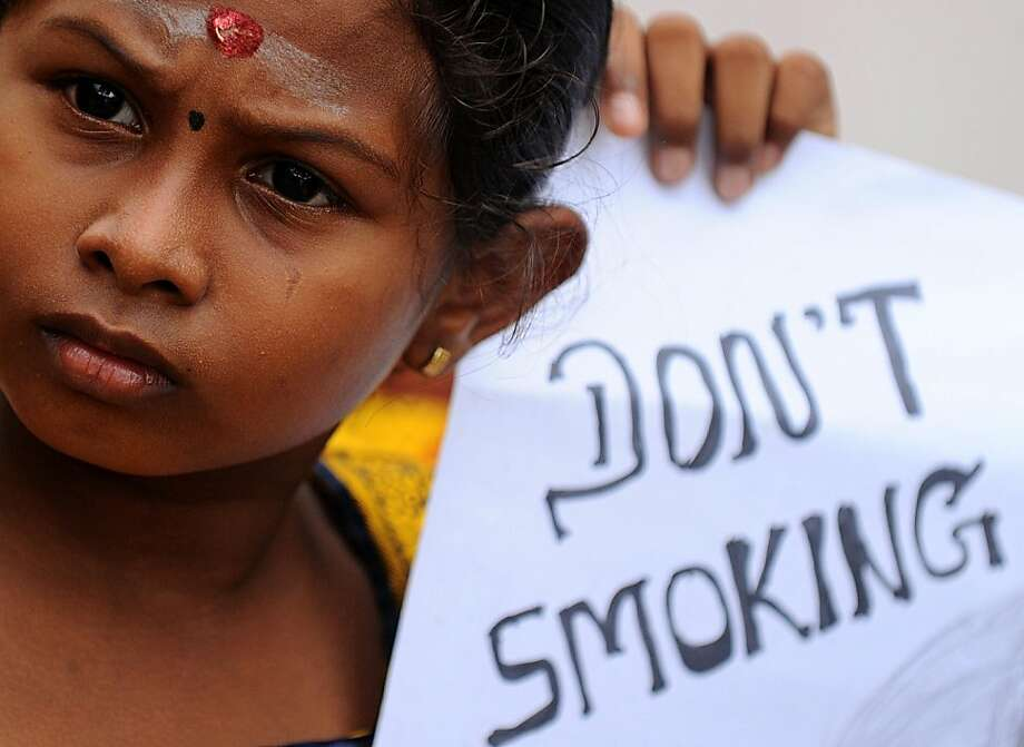 The message is clear even if the grammar isn'tduring a demonstration against tobacco and alcohol use in Colombo, Sri Lanka. Photo: Ishara S.Kodikara, AFP/Getty Images