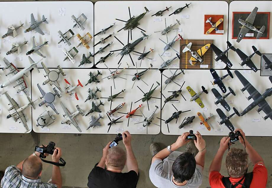 Gluers' white table:Visitors take pictures of airplane models at the model-making exhibition Modellbrno in Brno, Czech Republic. The exhibition is the largest one-day European get-together for plastic scale modelers, who compete in 60 different classes. Photo: Radek Mica, AFP/Getty Images