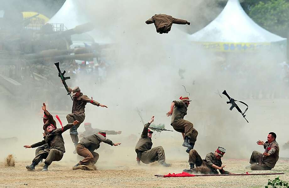 Theater of war: South Korean soldiers pretend to be hit by an exploding shell during a re-enactment of the Battle of Chuncheon, South Korea, at the beginning of the Korean War in 1950. Photo: Jung Yeon-je, AFP/Getty Images