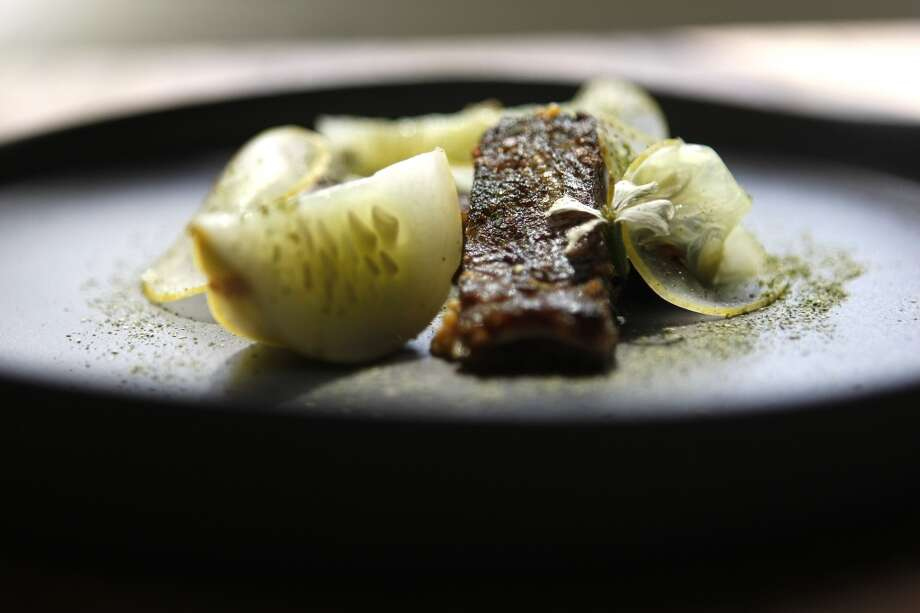 Tête de cochon with cucumbers cooked in whey sauce of brown butter and preserve lime at Oxheart restaurant  Sunday, June 10, 2012, in Houston. ( Johnny Hanson / Houston Chronicle ) Photo: Johnny Hanson, Houston Chronicle
