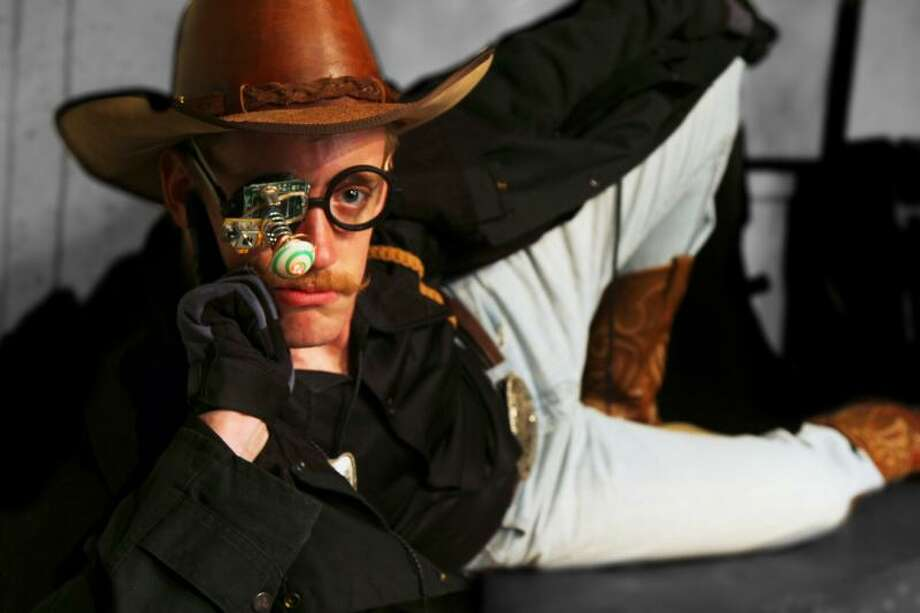 "Dru Barcus plays Willy, a space cowboy, in the Overtime Theater's ""Captain Cortez and the Tri-Lambda Brigade."" Courtesy Bryan Ortiz Photo: Courtesy Bryan Ortiz"