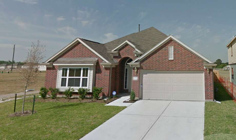 This Google Streetview image shows a Houston home which sold at auction for only $23.13.