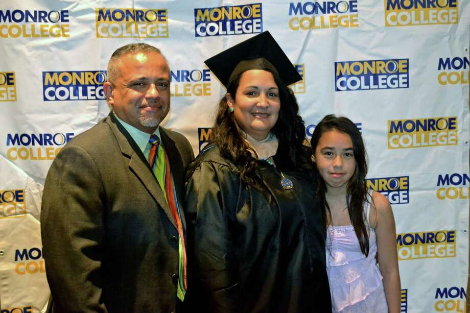 "Monroe College graduate Vennette ""Neena"" Perez, who runs a business in New Canaan, is flanked by her husband, Rudy, and his daughter, Stephanie, moments before she was awarded a bachelor's degree, summa cum laude, in hospitality management. Photo: Contributed"
