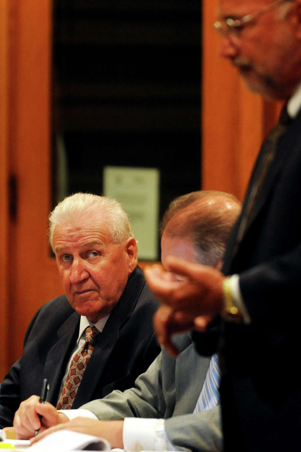 Dominic Badaracco Sr., left, listens as his attorney, Richard Meehan, right, speaks during the first day of his trial in Bridgeport Superior Court, in Bridgeport, Conn., June 24th, 2013. Badaracco is accused of offering a $100,000 bribe to Judge Robert Brunetti in 2010.
