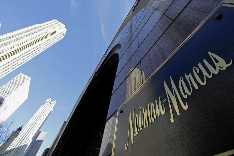 In this file photo, the Chicago skyline is reflected in the exterior of Neiman Marcus on Michigan Avenue in Chicago. Luxury retailer Neiman Marcus plans to raise up to $100 million from an initial public offering of its common stock. Photo: M. Spencer Green, Associated Press / Associated Press