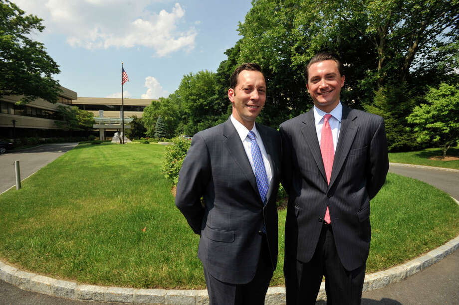Gregory Frisoli, left, is the executive managing director, and James Ritman is executive vice president and managing director of the Greenwich office of Newmark Grubb Knight Frank, a global commercial real estate firm. Photographed on Monday, June 24, 2013. Photo: Jason Rearick / Stamford Advocate