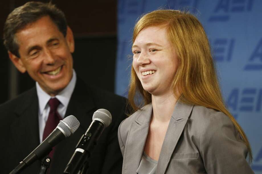"""Abigail Fisher, who sued the University of Texas when she was not offered a spot at the university's flagship Austin campus in 2008, with Edward Blum of the Project on Fair Representation, speaks at a news conference at the American Enterprise Institute in Washington, Monday, June 24, 2013. The U.S. Supreme Court ruling on affirmative action in higher education will have """"no impact"""" on the University of Texas' admissions policy, school president Bill Powers said Monday, noting UT will continue to use race as a factor in some cases.  (AP Photo/Charles Dharapak)"""