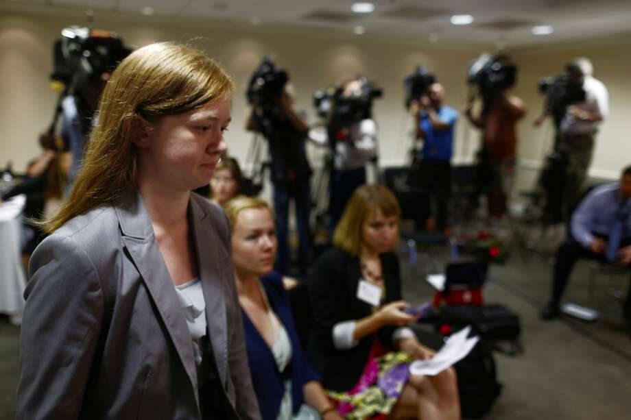 "Abigail Fisher, who sued the University of Texas when she was not offered a spot at the university's flagship Austin campus in 2008, arrives for a news conference at the American Enterprise Institute in Washington, Monday, June 24, 2013. The U.S. Supreme Court ruling on affirmative action in higher education will have ""no impact"" on the University of Texas' admissions policy, school president Bill Powers said Monday, noting UT will continue to use race as a factor in some cases.   (AP Photo/Charles Dharapak)"