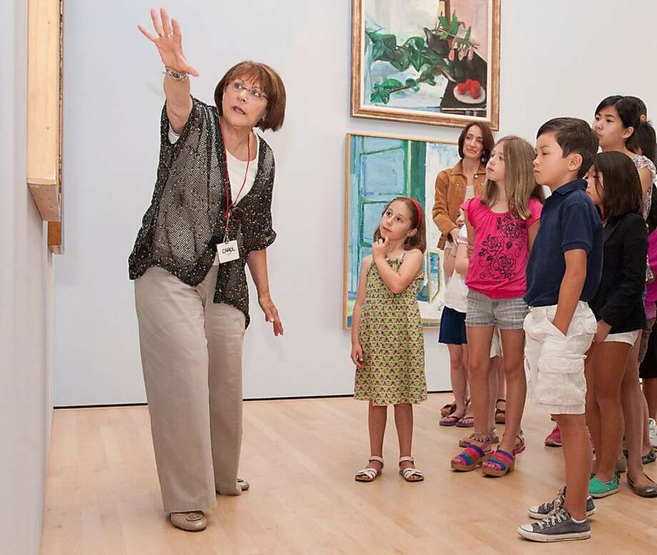 Docent Carol Toppel leads a tour. The 30-minute tour includes stops at six works of art. Photo: Linda Cicero