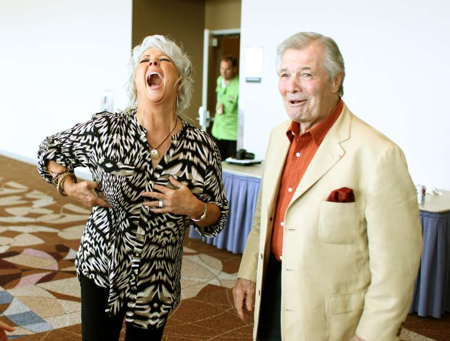 Paula Deen laughes at one of Jaques Pepin's jokes during The Metropolitan Cooking & Entertaining Show, Sunday, Sept. 16, 2012, in Reliant Center in Houston.  ( Nick de la Torre / Houston Chronicle )