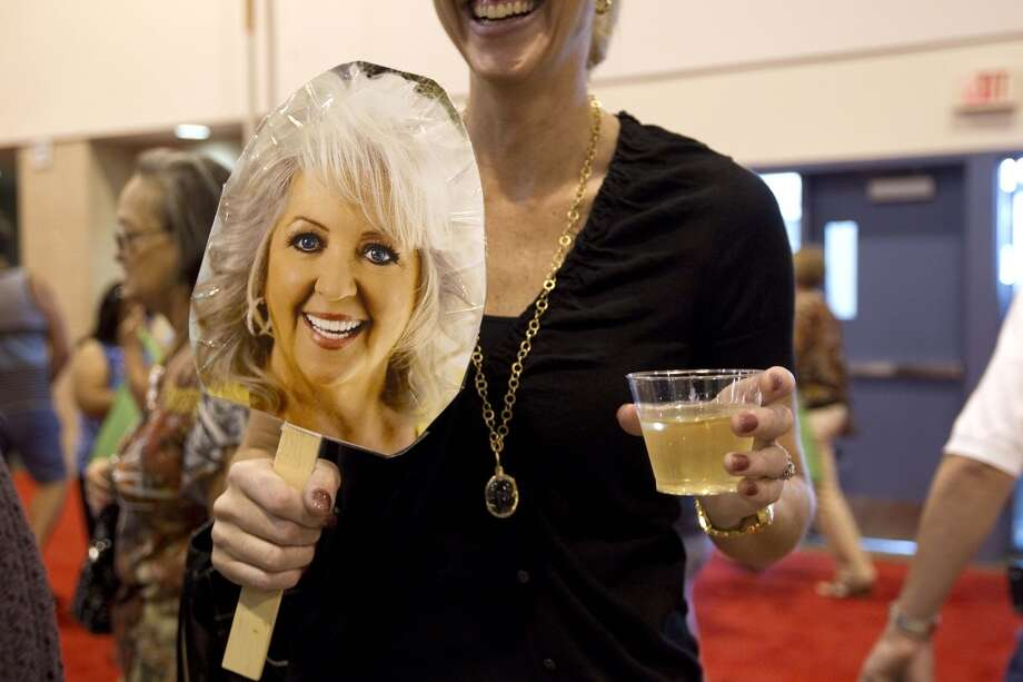 Stephanie Young, holds a picture of celebrity cook Paula Deen before her cooking demonstration during The Metropolitan Cooking & Entertaining Show at Reliant Center Friday, Sept. 14, 2012, in Houston.  The show, featuring more than 200 exhibitors and cooking stars Giada De Laurentiis, Paula Deen and Jacques Pepin runs through Sunday. ( Johnny Hanson / Houston Chronicle )
