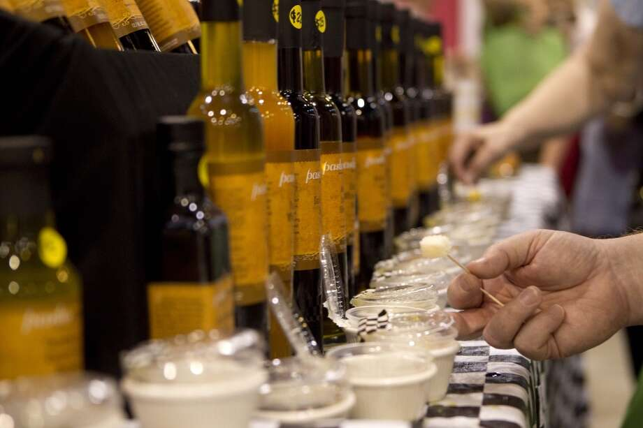Bill Wardell tries samples of different sauces and oils at the Pastamore exhibitor booth during The Metropolitan Cooking & Entertaining Show at Reliant Center Friday, Sept. 14, 2012, in Houston.  The show, featuring more than 200 exhibitors and cooking stars Giada De Laurentiis, Paula Deen and Jacques Pepin runs through Sunday. ( Johnny Hanson / Houston Chronicle )
