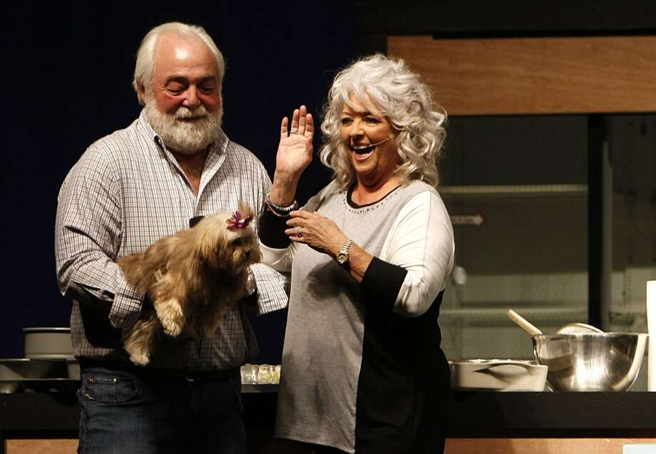 Celebrity cook Paula Deen and her husband Michael Groover introduced their new dog Lulu during her cooking demonstration at The Metropolitan Cooking & Entertaining Show at Reliant Center Friday, Sept. 14, 2012, in Houston.   The show, featuring more than 200 exhibitors and cooking stars Giada De Laurentiis, Paula Deen and Jacques Pepin runs through Sunday.  ( Johnny Hanson / Houston Chronicle )