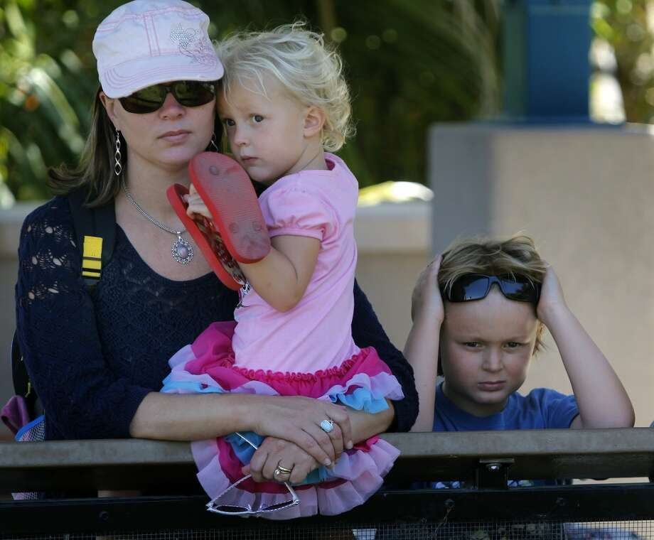 Carolyn Wheeler and her children Summer, 4, and Riley, 8, watch Duchess bask in the sun at the Oakland Zoo in Oakland.