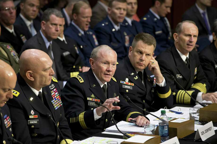 In a recent Senate Armed Services Committee hearing, lawmakers demanded answers from top uniformed leaders about whether a drastic overhaul of the military justice system is needed. Military lawyers should handle sexual assault prosecutions. Photo: J. Scott Applewhite, Associated Press