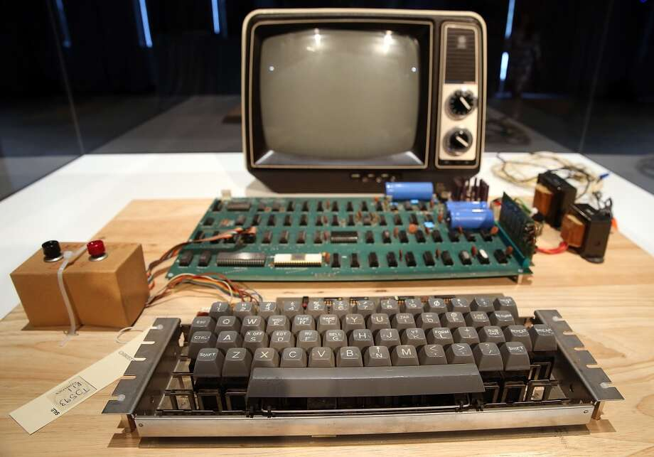 An Apple-1 computer, built in 1976, is displayed during the First Bytes: Iconic Technology From the Twentieth Century, an online auction featuring vintage tech products at the Computer History Museum on June 24, 2013 in Mountain View, California.  Christie's is auctioning off an original Apple-1 computer owned by Ted Perry as part of its First Bytes: Iconic Technology from the Twentieth Century, an online auction of vintage tech products.