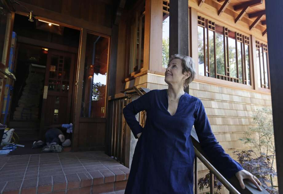 In this photo taken June 20, Alice Waters looks over the new front entrance.