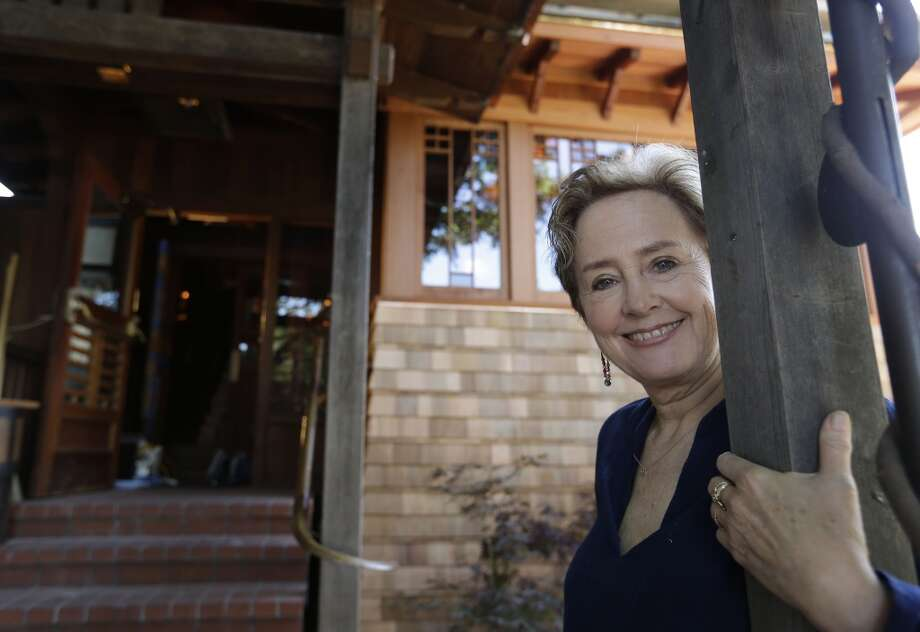 Alice Waters poses outside the new front entrance to Chez Panisse.