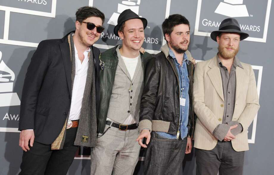 FILE - This Feb. 10, 2013 file photo shows, from left, Marcus Mumford, Ben Lovett, Country Winston and Ted Dwane, of  Mumford & Sons, at the 55th annual Grammy Awards in Los Angeles. The Grammy-winning band announced Monday, June 24, rescheduled dates in Dallas, Woodlands, New Orleans and Kansas City. The upcoming shows will include bassist Ted Dwane, who received treatment for a blood clot on his brain two weeks ago. (Photo by Jordan Strauss/Invision/AP, file) Photo: Jordan Strauss