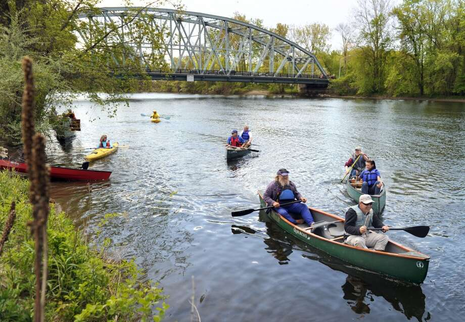 Canoeists arrive at Veterans Bridge in New Milford.