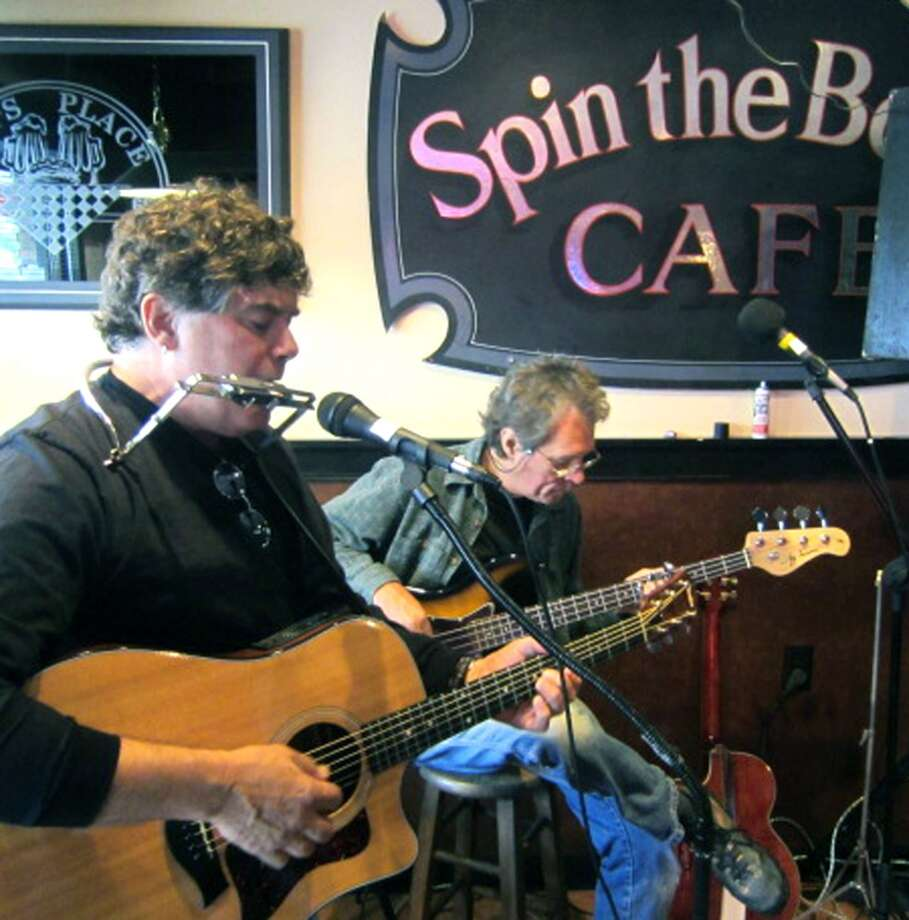 Mike Latini, left, and Jim Novak perform for a crowd in the Spin the Bottle Cafe at Daniel's Dining Car on Railroad Street during the Greater New Milford Chamber of Commerce's Harvest Festival.