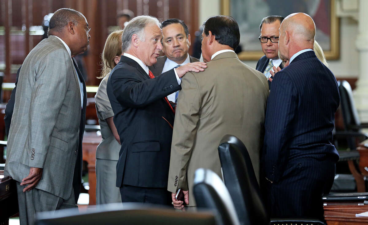 Democratic caucus leader Sen. Kirk Watson of Austin talks with Sen. Eddie Lucio Jr. of Brownsville, who supports a bill for tougher rules on abortions but voted against suspending rules so the bill could be taken up by the Senate on Monday.