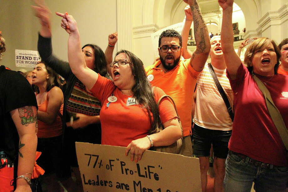 Protestors rant outside the house chamber after the House of Representatives passed abortion legislation on July 9, 2013. Photo: TOM REEL