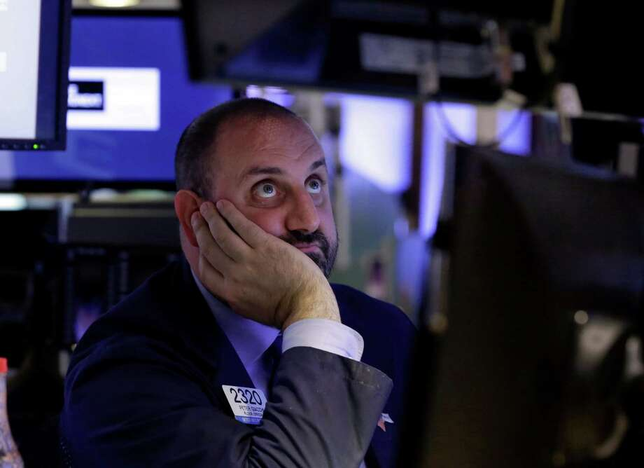 Specialist Peter Giacchi watches his screens as he works on the floor of the New York Stock Exchange, Monday, June 24, 2013. Traders in the U.S. dumped stocks, bonds and commodities, prompted by signs of distress in China's economy and worries about the end of the Federal Reserve bank's easy money policies. (AP Photo/Richard Drew) Photo: Richard Drew